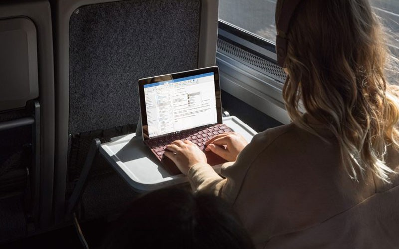 Business professional reading whitepaper off of Microsoft Surface computer